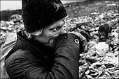 Katarzynowo, northern Poland, December 2005<br /> The faces of Polish poverty<br /> Andrzej Skarzynski,39, ex-worker at the collective farm in socialist Poland, now earns about 180 Euros a month working by the stove. With his wife they have 3 children. To make his living, he collects rubbish at the waste dump<br /> (&copy; Filip Cwik / Napo Images for Newsweek Polska)<br /> <br /> Katarzynowo k. Elku 07 grudzien 2005 Polska<br /> Oblicza biedy w Polsce<br /> Skarzynski Andrzej lat 39, pracowal w PGR do konca ich istnienia, trojka dzieci, zona pracuje w Elku on w Wisniowie jest palaczem i zarabia ok 600 zl miesiecznie. Na wysypisku zbiera stare buty i gume ktore pali w piecu aby ogrzac dom. Katarzynowo wies w warminsko - mazurskim 20 km od Elku. Typowa po PGR-owska wies zapomniana przez panstwo. Wiekszosc mieszkancow jest bez pracy. Okoliczne wysypisko smieci jest jedynym zrodlem dochodu wiekszosci rodzin. Zbieraja puszki, gume i wszystko co ma jakakolwiek wartosc  <br /> <br /> Wiekszosc Polakow niemal / 85% / z trudem radzi sobie z przezyciem od pierwszego do pierwszego. Ponad polowa / 52,5% / zalega ponad trzy miesiace z czynszem<br /> (&copy; Filip Cwik / Napo Images dla Newsweek Polska)