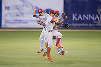 (L-R) Carlos Tocci (15), Cord Sandberg (17), and Jiandido Tromp (23) celebrate their win against the Kannapolis Intimidators at CMC-Northeast Stadium on May 16, 2015 in Kannapolis, North Carolina.  The BlueClaws defeated the Intimidators 9-7.  (Brian Westerholt/Four Seam Images)