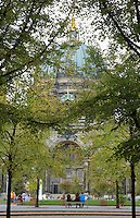 Berliner Dom or Berlin Cathedral, completed 1905 in Historicist style, seen through the leaves of trees, Museum Island, Mitte, Berlin, Germany. The church's full name is the Evangelical Supreme Parish and Collegiate Church. The buildings on Museum Island were listed as a UNESCO World Heritage Site in 1999. Picture by Manuel Cohen