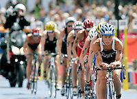 30 JUL 2006 - SALFORD, GBR - Andrea Hewitt leads a bike pack through transition during the Salford round of the ITU World Cup (PHOTO (C) NIGEL FARROW)