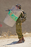 An Israeli soldier aims his rifle from behind the cover of his riot shield during clashes with stone throwing Palestinian youths in the streets of the West Bank town of Beit Jala near Bethlehem on 04/07/2010.