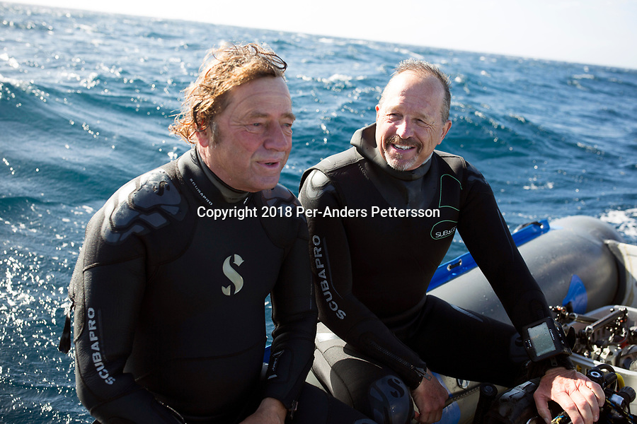MARGATE, SOUTH AFRICA APRIL 25: Shark expert and biologist Erich Ritter (r) speaks Roland Mauz, the owner of African Adventure diving, in a boat during a diving excursion, during an early morning dive at Protea Banks on April 25, 2018 in KwaZulu Natal, South Africa. The area is one of the best in South Africa for shark encounters. (Photo by: Per-Anders Pettersson/Getty Images)