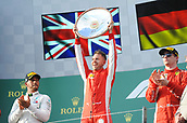 25th March 2018, Melbourne Grand Prix Circuit, Melbourne, Australia; Melbourne Formula One Grand Prix, race day; Sebastian Vettel (Germany) of Ferrari celebrates his 2018 Australian Grand Prix winwith the trophy applauded by Hamilton