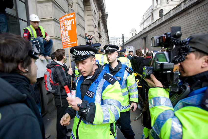 Thousands of protesters marched on the Bank of England incity of London during the G20 conference meeting  in London April 2009 , RBS  Bank windows were smashed on the ground floor. Police made around 90 arrests.