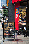 Advertisements of the Burger King's new black burgers on display outside the Shinjuku store on August 21, 2015, Tokyo, Japan. The chain's two new black burgers use bamboo charcoal-infused buns and cheese, Black Hashed Sauce (a mix of red wine, squid ink, onions, tomato and crushed garlic), and slices of grilled eggplant. In July Burger King launched two red burgers in another Japan only colored burgers promotion. The two new black burgers are the Kuro Shogun costing 690 JPY (5.59 USD) and the Kuro Taisho costing 590 JPY (4.78 USD). They will be on sale for a limited time in Burger King's Japanese stores from August 21st. (Photo by Rodrigo Reyes Marin/AFLO)