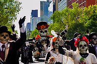 A gigantic Calaca figure, a Mexican icon representing the deceased, is carried on the street during the Day of the Dead celebrations in Mexico City, Mexico, 29 October 2016. Day of the Dead (Día de Muertos), a syncretic religious holiday combining the death veneration rituals of the ancient Aztec culture with the Catholic practice, is celebrated throughout all Mexico. Based on the belief that the souls of the departed may come back to this world on that day, people gather at the gravesites in cemeteries praying, drinking and playing music, to joyfully remember friends or family members who have died and to support their souls on the spiritual journey.