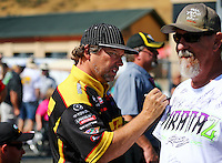 Jul. 27, 2014; Sonoma, CA, USA; NHRA funny car driver Del Worsham signing a fans t-shirt during the Sonoma Nationals at Sonoma Raceway. Mandatory Credit: Mark J. Rebilas-