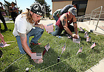 Volunteers with the Western Nevada College Veterans Resource Center plant nearly 8,000 American flags at the campus in Carson City, Nev., on Friday, May 1, 2015. The group will hold a Veterans Suicide Walk Saturday, May 2 starting at 10 a.m. at Bully's Sports Bar and Grill to help raise awareness of the 8,030 veteran suicides each year. <br /> Photo by Cathleen Allison/Nevada Photo Source