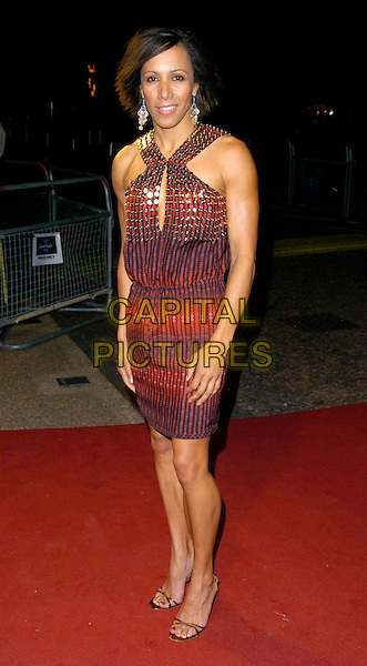 "DAME KELLY HOLMES.Arrivals - ""An Audience With Lionel Richie"" TV recording, ITV Television Centre, Aouth Bank, London, England, December 9th 2006..full length red gold patterned dress strappy shoes sandals.CAP/CAN.©Can Nguyen/Capital Pictures"