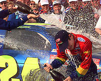Jeff Gordon gets a champagne dousing during a victory lane celebration after winning the Daytona 500 at Daytona International Speedway in Daytona Beach, Fl.