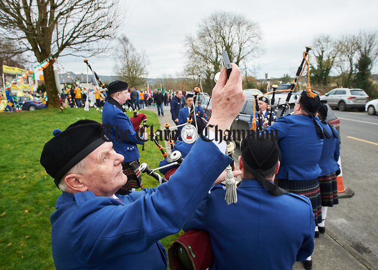Des O Halloran sets about tuning the instruments of fellow members of Tulla Pipe Band ahead of the St Patrick's Day parade in Sixmilebridge. Photograph by John Kelly.