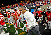 Ohio State Buckeyes head coach Urban Meyer runs onto the field for warm-ups prior to the Big Ten Championship against the Northwestern Wildcats at Lucas Oil Stadium in Indianapolis on Dec. 1, 2018. [Adam Cairns/Dispatch]