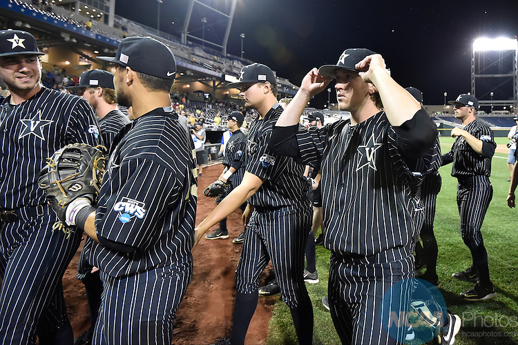 22 JUN 2015: Carson Fulmer (15) of Vanderbilt University walks to the dugout during the Division I Men's Baseball Championship held at TD Ameritrade Park in Omaha, NE. Vanderbilt defeated Virgina 5-1 in game one of the best of three series. Justin Tafoya/NCAA Photos
