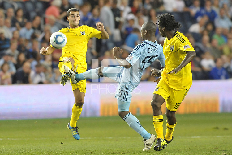 Dilly Duka Columbus Crew midfielder gets the cross in before the attempted block from Sporting KC defender Julio Cesar (55)... Sporting Kansas City defeated Columbus Crew 2-1 at LIVESTRONG Sporting Park, Kansas City, Kansas.