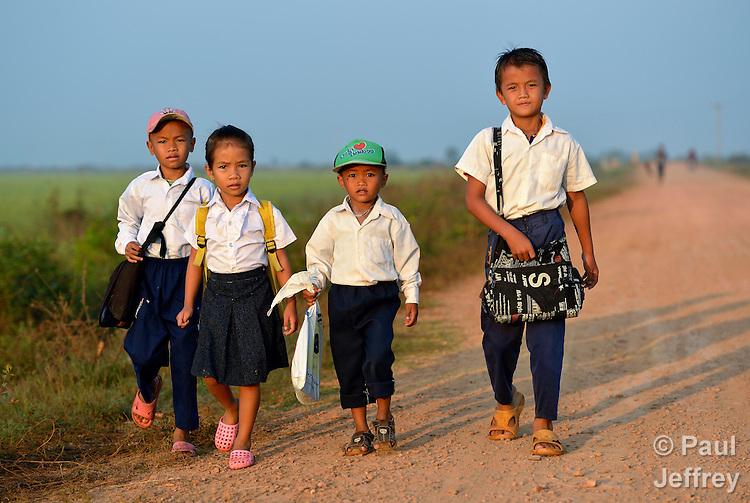 Children walk to school in the village of Chek Angkor in northern Cambodia.