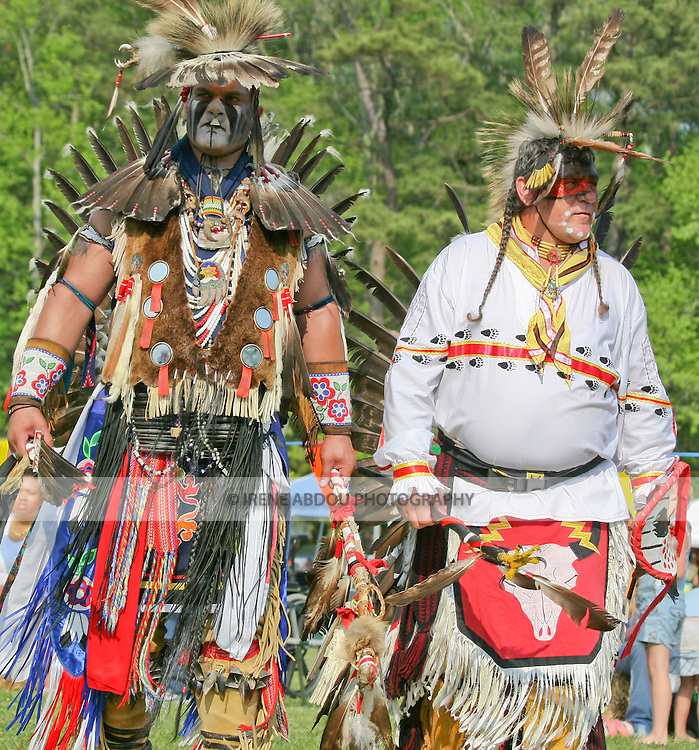 Native American men dance in full traditional regalia at the 8th Annual Red Wing PowWow in Virginia Beach, Virginia.
