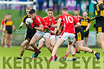 Liam Kearney, East Kerry in action against Johnny Buckley and Gavin O'Shea, Dr Crokes  during the Kerry County Senior Club Football Championship Final match between East Kerry and Dr. Crokes at Austin Stack Park in Tralee, Kerry.