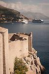 Walled city (stari grad) of Duvbrovnik, founded c. 972 along the Dalmatian Coast on the Adriatic Sea in Croatia--stone walls and the sea--cruise ships
