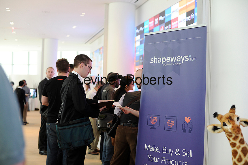Job seekers at the Shapeways booth at  the Fourth Annual NYC Startup Job Fair in New York on Friday, April 19, 2013.  The Labor Department reported a rise in unemployment benefit applications for last week. (© Frances M. Roberts)