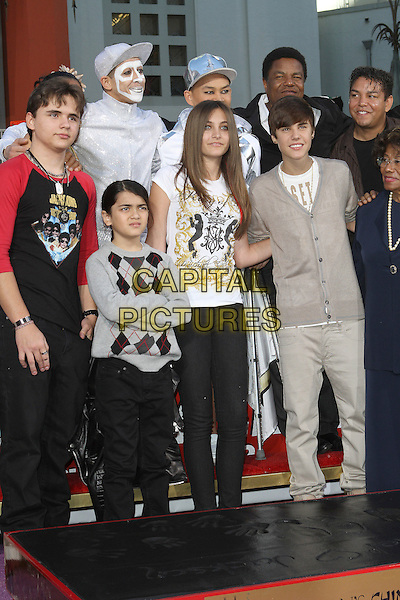 Prince Jackson, Paris Jackson, Blanket Jackson, Justin Bieber.Grauman's Chinese hand and foot print ceremony for the late Michael Jackson, celebrating the Los Angeles debut of Michael Jackson THE IMMORTAL World Tour by Cirque du Soleil held at Grauman's Chinese Theatre, Hollywood, California, USA..January 26th, 2012.full length white t-shirt  black leather jeans denim jacket jeans denim grey gray argyle jumper sweater siblings jacket cardigan.CAP/ADM/KB.©Kevan Brooks/AdMedia/Capital Pictures.