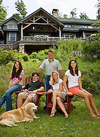 The Routh family outside their log cabin in the Adirondack mountains