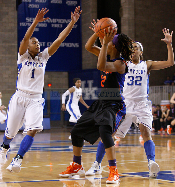 UK guards Kastine Evans (R) and A'dia Mathies (L) guard a Florida player during the second half of the UK Women's basketball game against Florida on 1/22/12 at Memorial Coliseum in Lexington, Ky. Photo by Quianna Lige | Staff