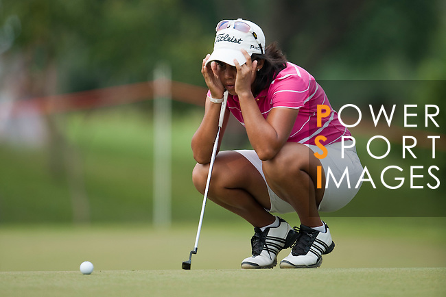 CHON BURI, THAILAND - FEBRUARY 16:  Julieta Granada of Paraguay lines up a putt on the 14th green during day one of the LPGA Thailand at Siam Country Club on February 16, 2012 in Chon Buri, Thailand.  Photo by Victor Fraile / The Power of Sport Images