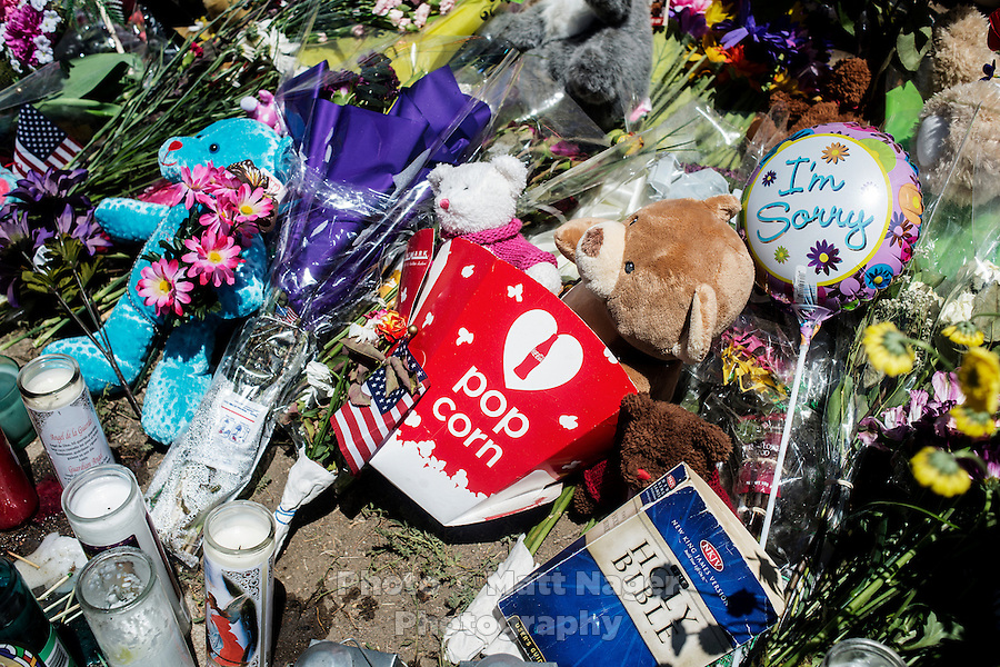 A shrine for the victims of the shooting at an Aurora Century 16 theater where James Holmes (cq), 24, killed 12 people and wounded many more in Aurora, Colorado, Sunday, July 22, 2012. The shootings occurred during the midnight premiere of the new Dark Knight Batman movie...Photo by MATT NAGER