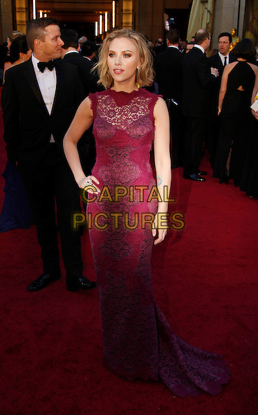 SCARLETT JOHANSSON.83rd Annual Academy Awards - Oscars.Kodak Theatre, Hollywood, CA, USA..February 27th, 2011.full length dress maxi red purple fuschia sleeveless lace hand on hip.CAP/PE.©Peter Eden/Capital Pictures.