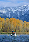 08235-D. Anglers cast flies for trout from a drift boat during an autumn afternoon on the South Fork of the Snake River, Idaho.