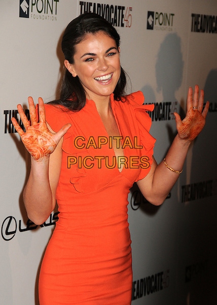 Serinda Swan.The Advocate 45th Benefiting The Point Foundation held at the Beverly Hilton Hotel, Beverly Hills, California, USA..March 29th, 2012.half length dress hand on hip orange ruffle hands palms henna tattoo smiling .CAP/ADM/BP.©Byron Purvis/AdMedia/Capital Pictures.