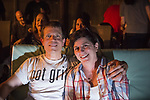 "Merrick, New York, USA. 11th June 2017.  ""American Grit"" TV contestant CHRIS EDOM, 48, (wearing GOT GRIT? T-shirt) has his arm around shoulder of  his wife JOAN EDOM, both of Merrick, as they host backyard Viewing Party for Season 2 premiere. Show. Edom family and neighbors watched Episode 1 of FOX network reality television series that Sunday night outdoors."