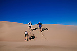 Central Coast Outdoors Tour Guide Craig Stone (right) hikes a dunes with Jasmine Hemery and Brad Smith on a half day tour that involves kayaking the bay and then hiking in secluded dunes in Morro Bay, California December 22, 2014.