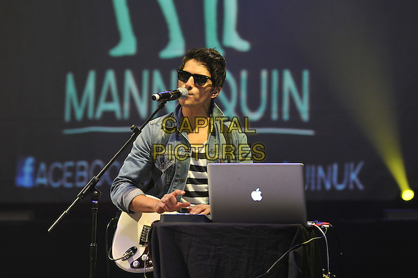 Reuben Priddy.Mannequin performing live in concert, Hammersmith Apollo, London, England. 6th December 2011.on stage gig performance music half length black jean denim sunglasses shades singing apple mac laptop computer .CAP/MAR.© Martin Harris/Capital Pictures.