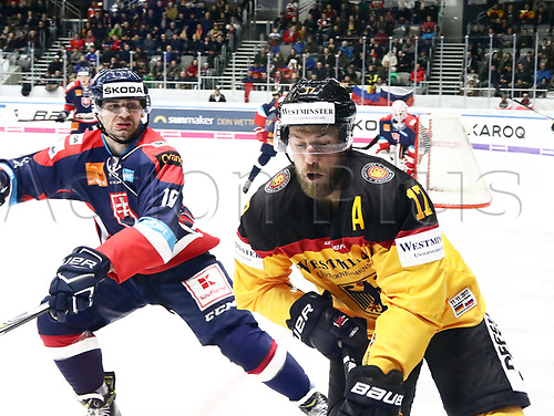 11th November 2017, Curt Frenzel Stadium, Augsburg, Germany; 2017 Deutschland Cup, Germany versus Slovakia;  Juraj VALACH (Slovakia)follows Markus KINK (Germany) into the boards