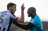 Adebayo Akinfenwa of Wycombe Wanderers & Shaun Pearson of Grimsby Town during the Sky Bet League 2 match between Grimsby Town and Wycombe Wanderers at Blundell Park, Cleethorpes, England on 4 March 2017. Photo by Andy Rowland / PRiME Media Images.