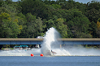 Frame 5: Dan Orchard, (#97) spins and rolls over in the East Turn. (SST-120 class)