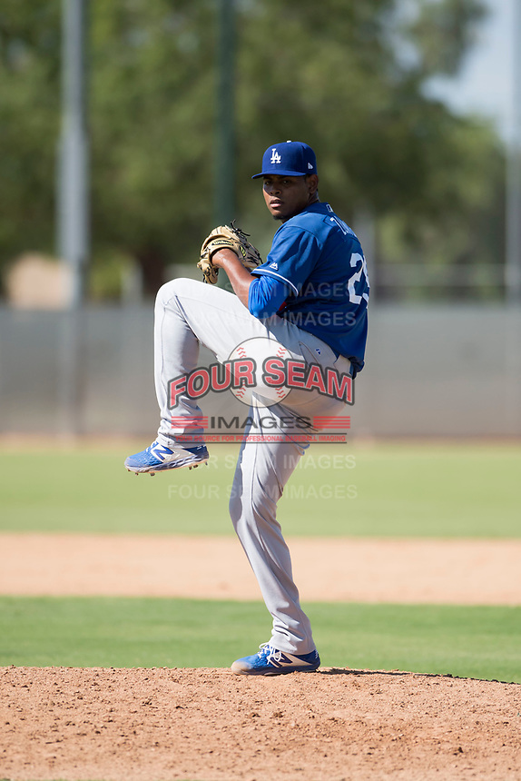 Los Angeles Dodgers relief pitcher Guillermo Zuniga (29) delivers a pitch during an Instructional League game against the Milwaukee Brewers at Maryvale Baseball Park on September 24, 2018 in Phoenix, Arizona. (Zachary Lucy/Four Seam Images)