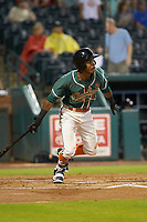 Jose Devers (2) of the Greensboro Grasshoppers follows through on his swing against the West Virginia Power at First National Bank Field on June 1, 2018 in Greensboro, North Carolina. The Grasshoppers defeated the Power 10-3. (Brian Westerholt/Four Seam Images)