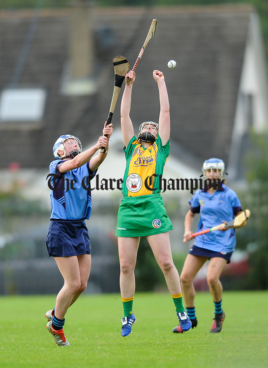 Roisin Powell of Truagh-Clonlara in action against Fiona Lafferty of Inagh-Kilnamona during their first round senior championship game in Shannon. Photograph by John Kelly