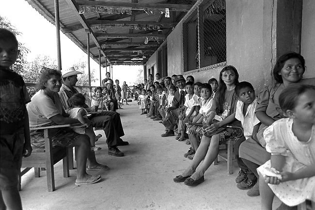 A crowd of people waits to see a dentist at a volunteer dental clinic in Rural Honduras.