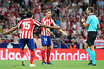 Atletico de Madrid's Stefan Savic (l) and Marcos Llorente have words with Spanish referee Guillermo Cuadra Fernandez during La Liga match. August 18,2019. (ALTERPHOTOS/Acero)