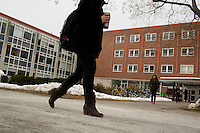 Students walk past Joseph Warren Bartlett Hall on the campus of the University of Massachusetts-Amherst in Amherst, Massachusetts, USA. The building is planned to be demolished as part of an ongoing plan to restructure the school's footprint. The building currently houses a few academic departments, including English and Journalism, and classrooms.