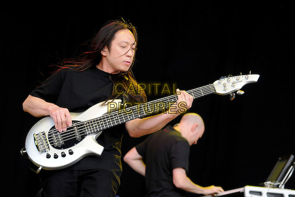 DREAM THEATER - JOHN MYUNG.Download Festival 2009 - Day Three.Donington Park, Derbyshire, England, UK, 14th June 2009..on stage live music concert gig half length band black t-shirt playing electric guitar .CAP/BRC.©Ben Rector/Capital Pictures