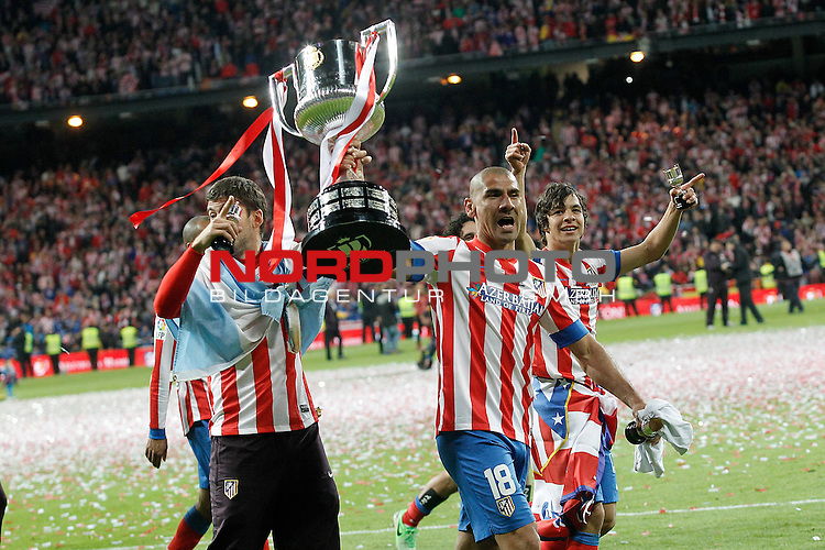 Atletico de Madrid's Cata Diaz (c) and Oliver Torres celebrate the victory in spanish KIng's Cup Final match.May 17,2013. Foto © nph / Acero)