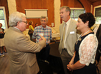 NWA Democrat-Gazette/ANDY SHUPE<br /> Lamar Pettus (from left), interim director of the Mount Sequoyah Retreat and Conference Center in Fayetteville, and Richard Hudson, speak Wednesday May 25, 2016, with Jess Schload and his wife, Connie Bartosiewicz, during a reception for Schload who was introduced as the new CEO of the center.