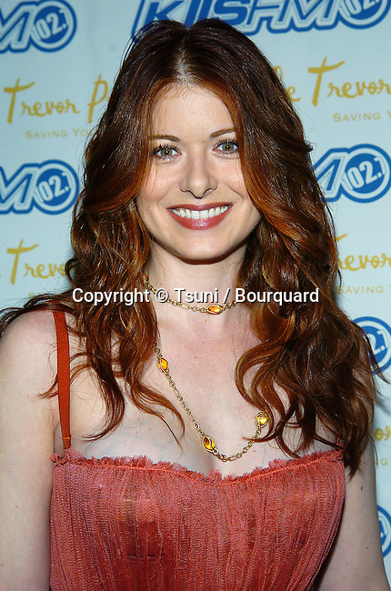Debra Messing arriving at the Trevor Project's Cracked Xmas 7 at the Wiltern Theatre in Los Angeles. December 5, 2004.
