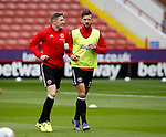John Lundstram of Sheffield Utd  and Jake Wright of Sheffield Utd  warming up during the Championship League match at Bramall Lane Stadium, Sheffield. Picture date 19th August 2017. Picture credit should read: Simon Bellis/Sportimage