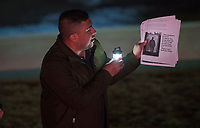 NWA Democrat-Gazette/J.T. WAMPLER Irvin Camacho of Springdale reads a profile of a migrant Wednesday Dec. 5, 2018 during a vigil at Walter Turnbow Park in Springdale to show solidarity with the Central Americans making their way to the southern United States border. Around 30 people participated in the event.