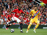Paul Pogba of Manchester United in action with Luka Milivojevic of Crystal Palace during the English Premier League match at the Old Trafford Stadium, Manchester. Picture date: May 21st 2017. Pic credit should read: Simon Bellis/Sportimage
